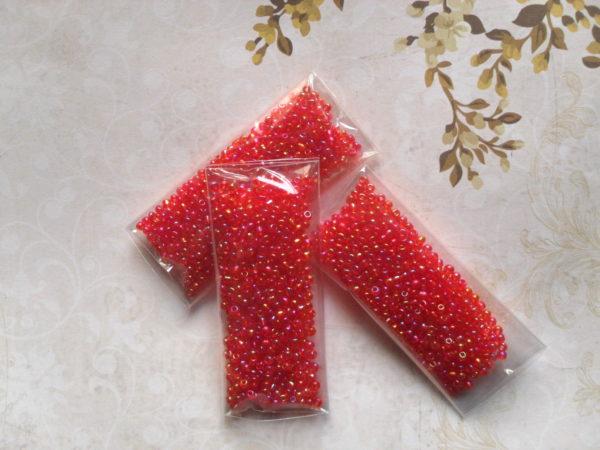 Perles rouges orangées brillantes